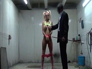 BDSM hardcore scene in a garage with a blonde with pigtails