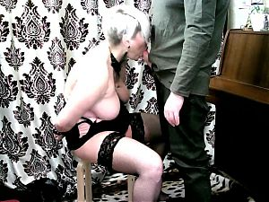 Naughty MILF bitch gives blowjob in handcuffs while kneeling